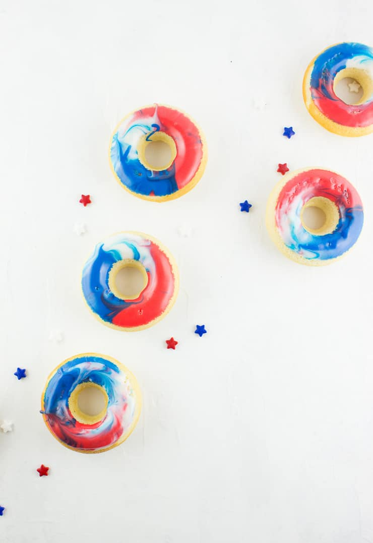 Give your 4th of July morning (or your afternoon BBQ) an extra bit of color with these red, white, and blue 4th of July doughnuts! | The Simple, Sweet Life