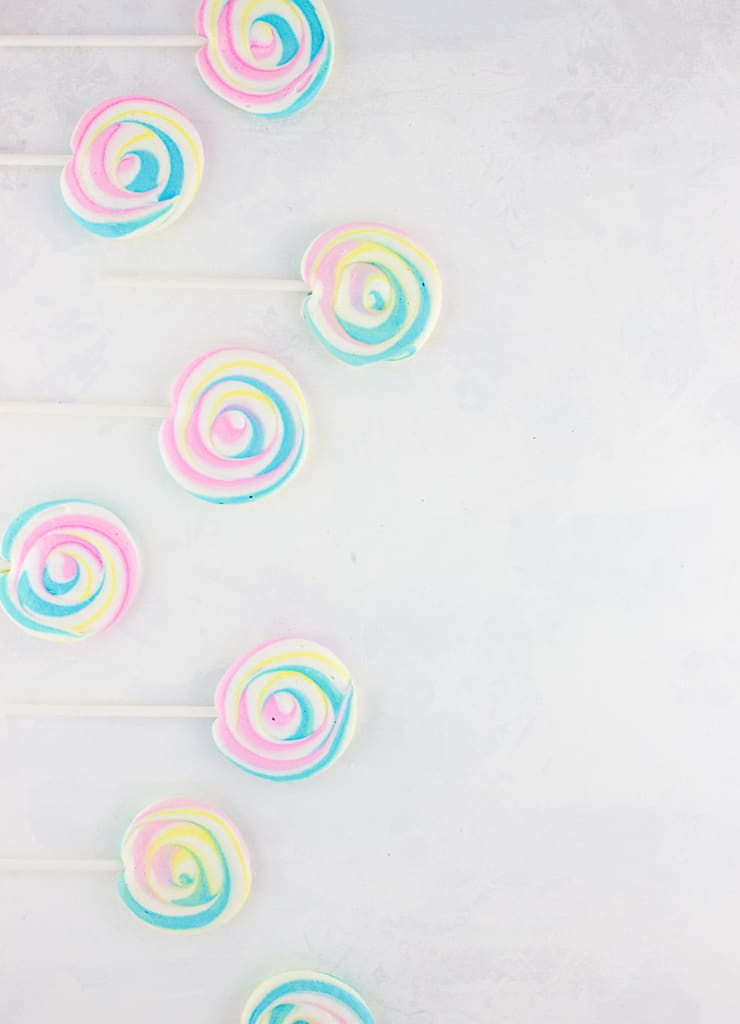 These beautiful pastel meringue lollipops couldn't be any sweeter or easier. A sure to please treat for kids and adults alike! | The Simple, Sweet Life