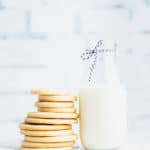stack of sugar cookies next to a glass of milk