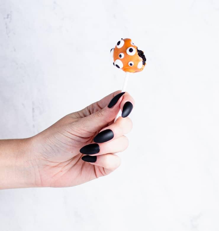 hand holding a half eaten cake pop