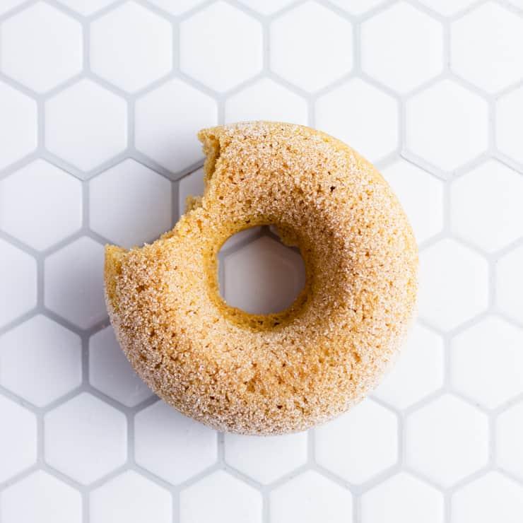 overhead shot of a sweet potato doughnut missing a bite