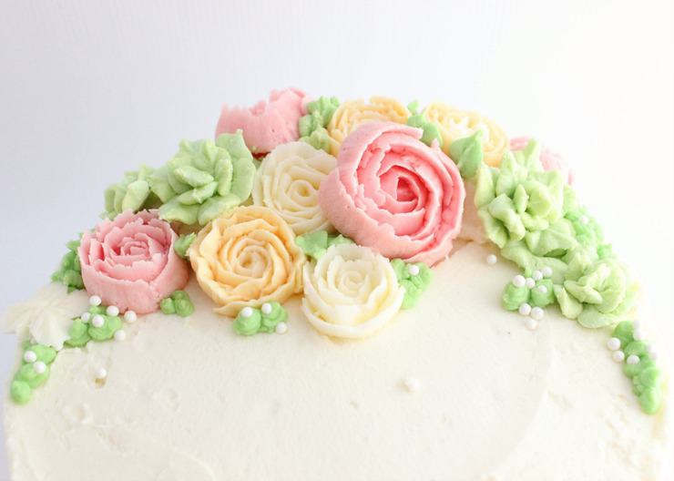An easy tutorial on how to decorate a cake with buttercream flowers
