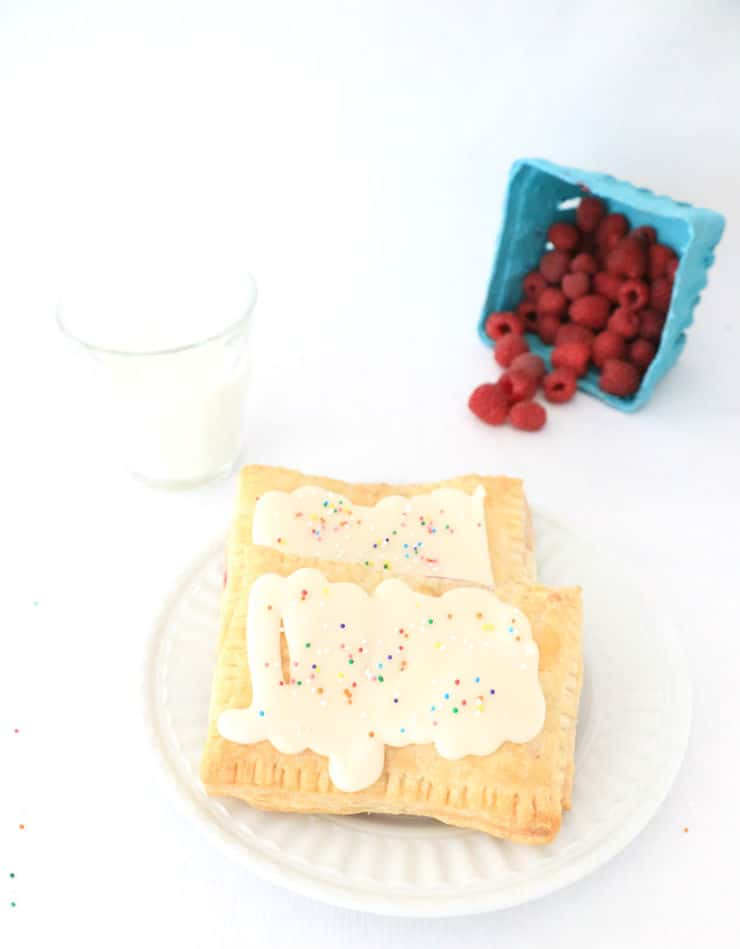 These delectable pastries have a flaky puffy pastry outside, fresh berry-filled inside, and are topped with delicious vanilla icing!
