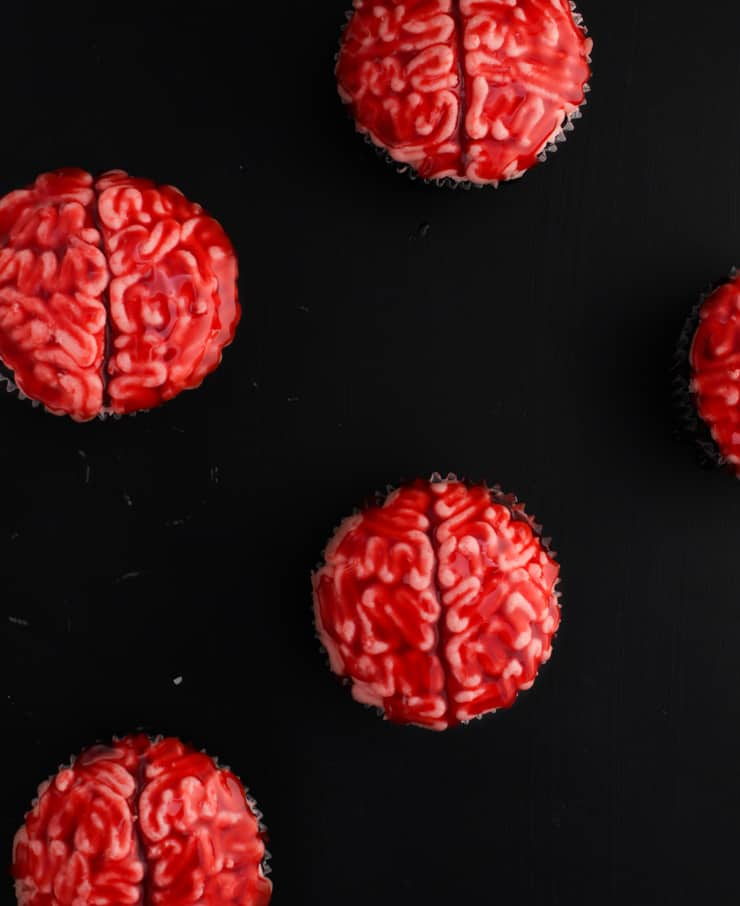 bleeding brain cupcakes against a black backdrop