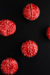 bleeding brain cupcakes against a black backdrop