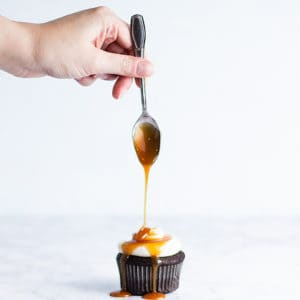 drizzling caramel onto cupcakes
