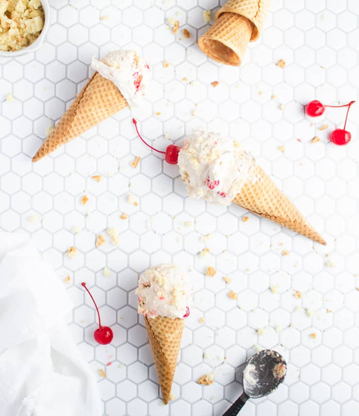 ice cream cones scattered across a tiled backdrop