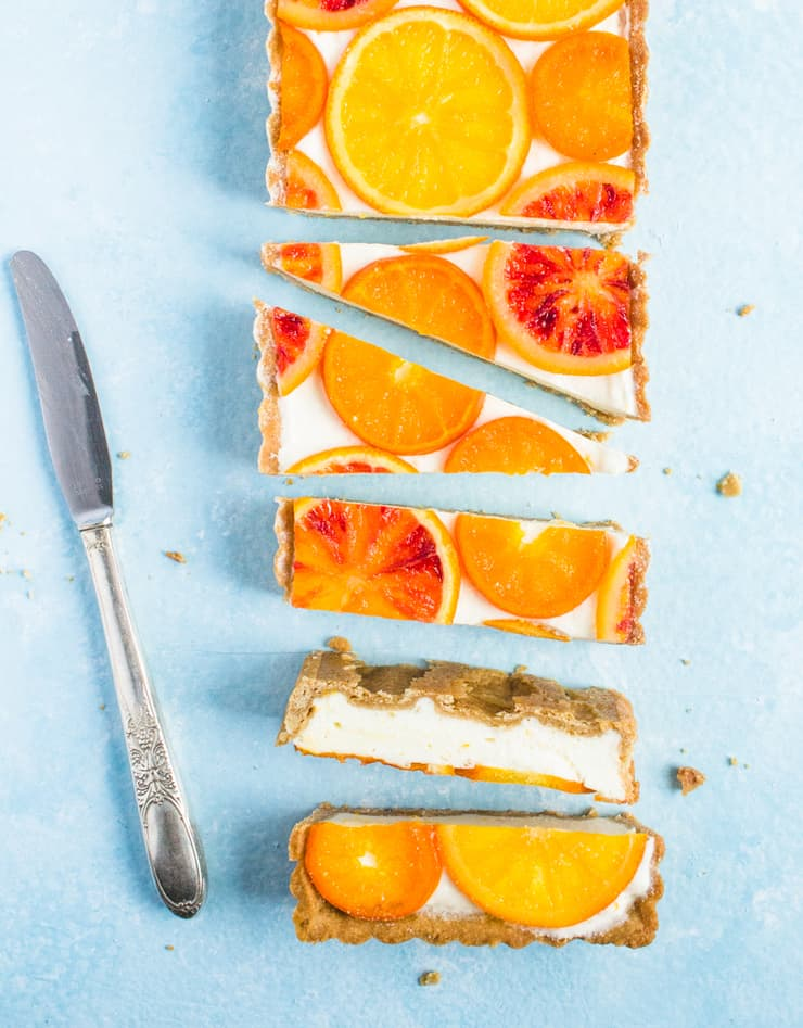 This mimosa tart is everything you love about brunch and then some! With it's bright candied oranges, boozy champagne filling and to-die-for graham cracker crust, what's not to love?