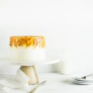 caramel macchiato cake next to plates