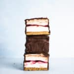 Three stacked raspberry s'more bars