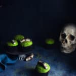 green cupcakes with fondant fingers against a dark backdrop