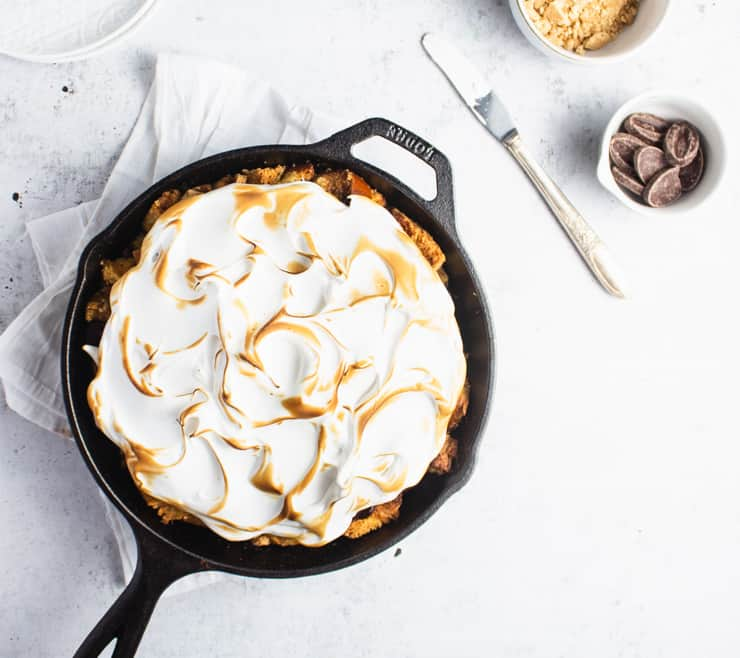 skillet french toast with toasted meringue and a bowl of graham cracker and chocolate next to it
