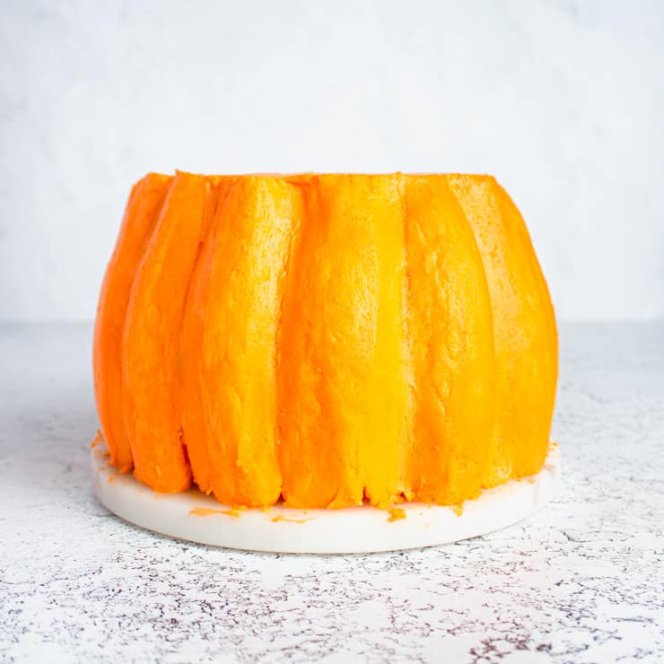 buttercream pumpkin cake with smooth ridges