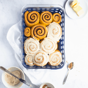 baked cinnamon rolls that are partially iced