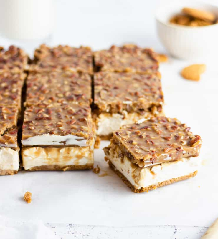 sliced pecan pie cheesecake bars