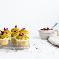 side view of cupcakes with a bowl of dried roses in the background