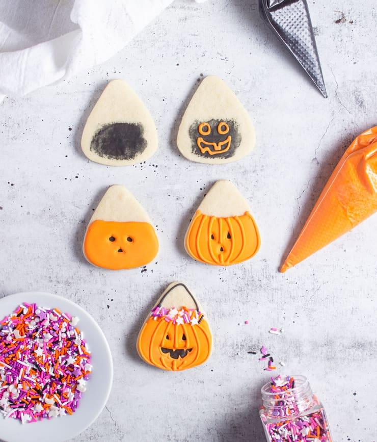 progression of iced treat bucket jack-o-lantern cookies