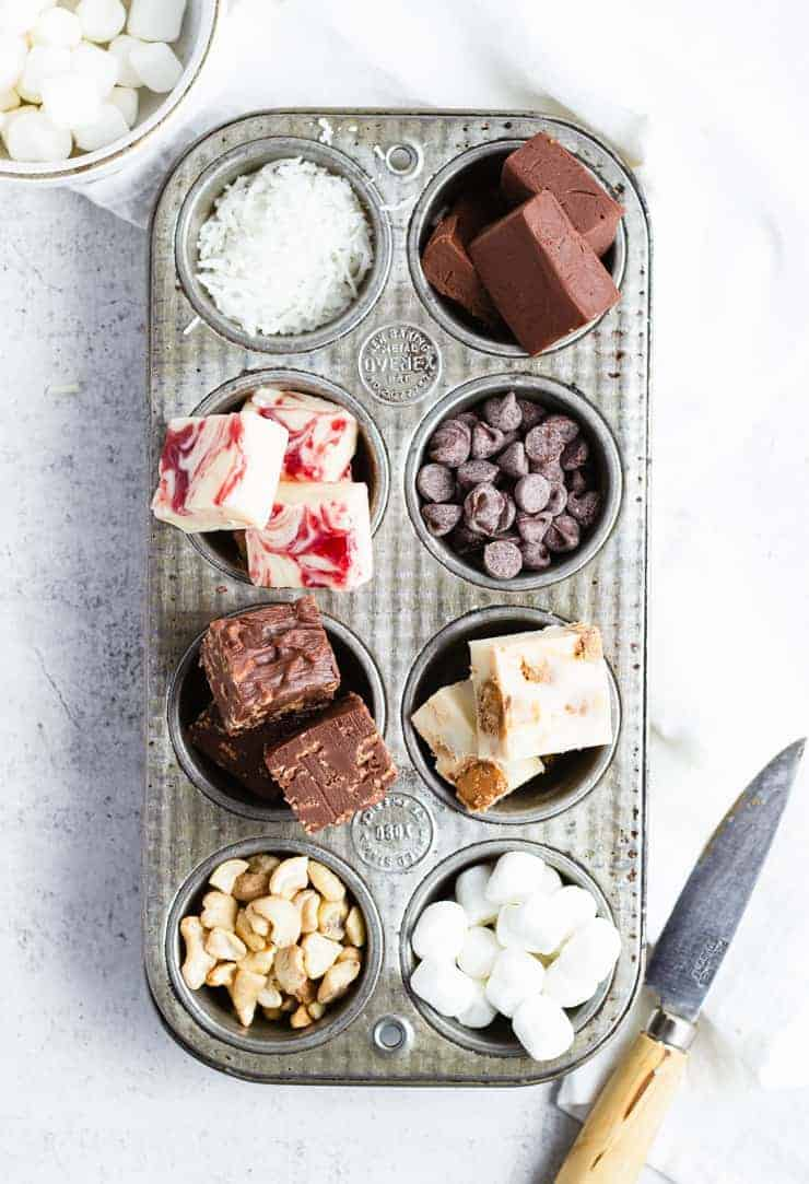 overhead shot of different kinds of fudge in a cupcake pan